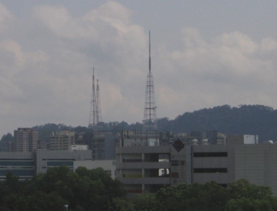 Transmitting station in distance behind buildings, Singapore