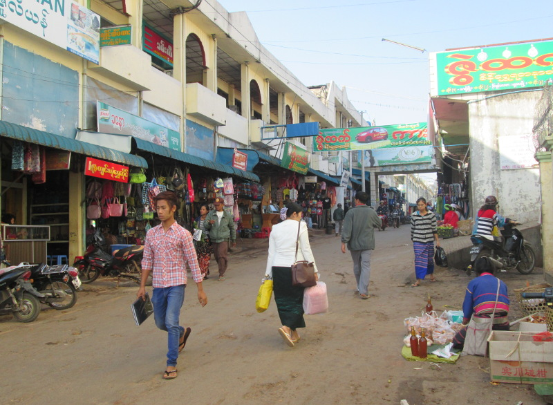 Street in market area with pedestrians and vendors